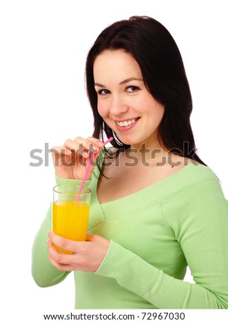 Young attractive woman drinks orange juice using drinking straw, isolated over white - stock photo