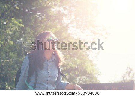 Young attractive woman enjoy with nature surrounding, achieved adventure.