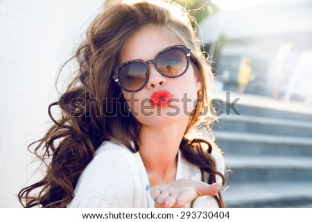 Young attractive woman face over isolated white background,send kiss,with red lips,amazing woman,hairstyle after salon,beauty face,party make-up,summer accessories,perfect bronze tan skin,lovely face - stock photo
