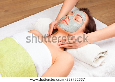 Young attractive woman getting treatment  in the spa salon