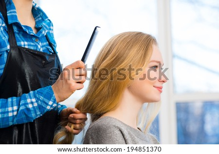 young attractive woman hairdresser hairstyle customer picks - stock photo