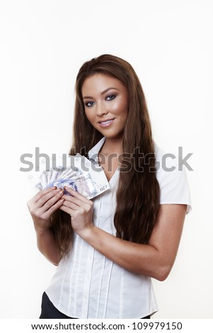 young attractive woman holding a hand full of english back notes - stock photo
