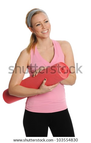Young attractive woman holding a pink yoga mat. Isolated on white - stock photo