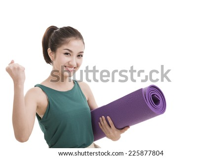 Young attractive woman holding a yoga mat. Isolated on white - stock photo