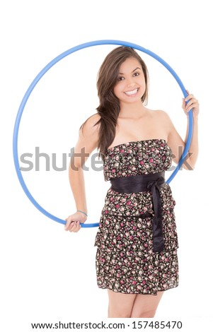 Young attractive woman holding hula hoop - stock photo