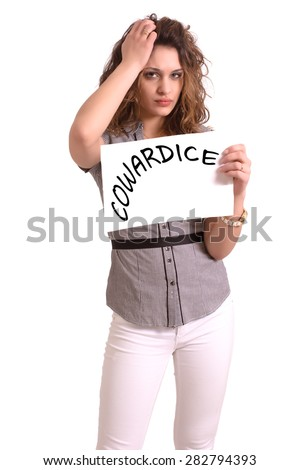 Young attractive woman holding paper with Cowardice text on white background