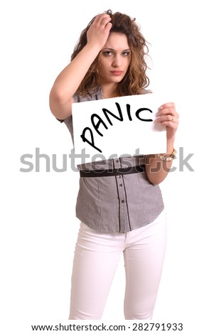 Young attractive woman holding paper with Panic text on white background