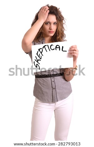 Young attractive woman holding paper with Skeptical text on white background