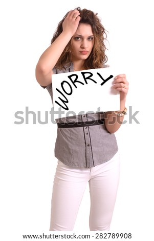 Young attractive woman holding paper with Worry text on white background