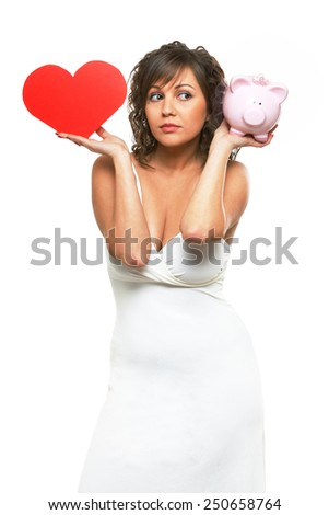Young attractive woman holding red paper heart like a valentine card and pink piggy bank - stock photo