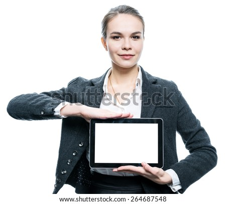 young attractive woman holding tablet computer with blank screen - stock photo