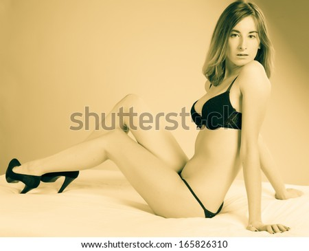 young attractive woman in beautiful black lingerie - stock photo