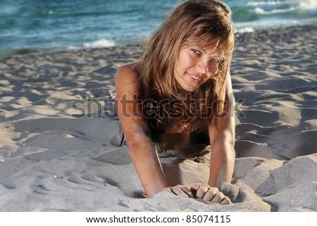 young attractive woman in bikini on sand beach - stock photo