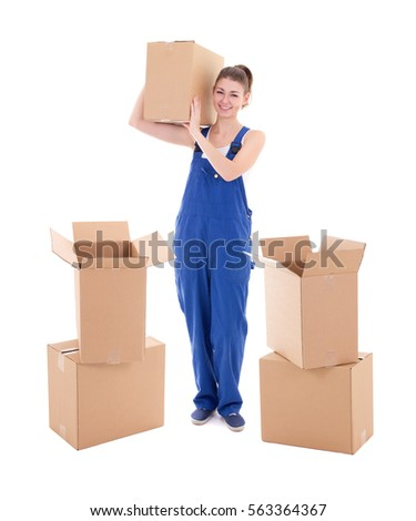 young attractive woman in blue workwear with cardboard boxes isolated on white background