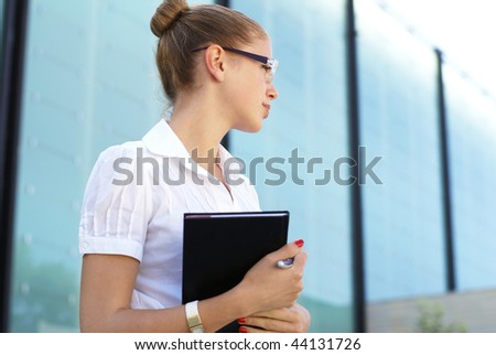 Young attractive woman in casual dress (student or businesswoman)