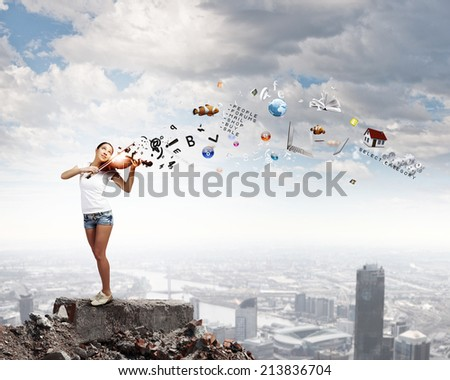 Young attractive woman in casual playing violin - stock photo