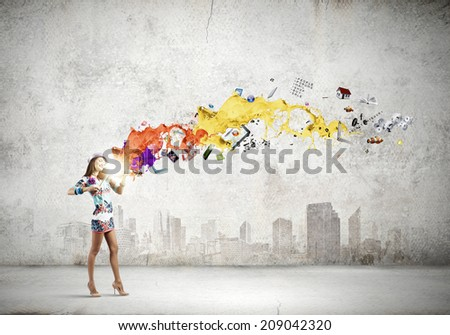 Young attractive woman in colored dress playing violin - stock photo