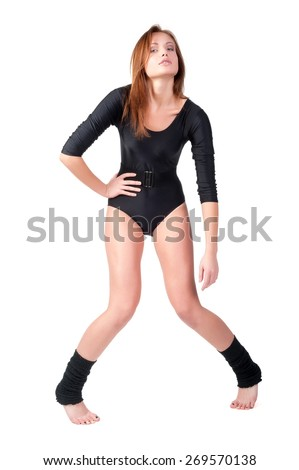 Young attractive woman in gymnast suit. Isolated over white background