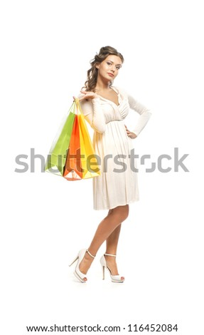 Young attractive woman in mask over dark background - stock photo