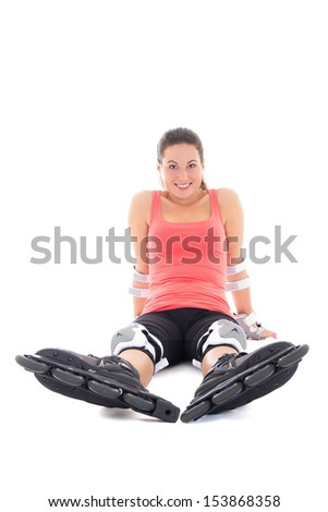 young attractive woman in roller skates sitting isolated on white background
