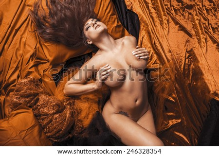 Young attractive woman posing in erotic lingerie. - stock photo