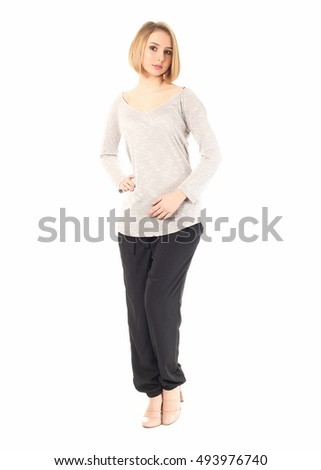 Young attractive woman posing in studio. Casual stile