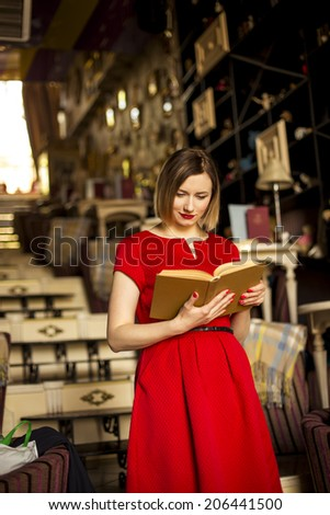 Young attractive woman reading a book - stock photo