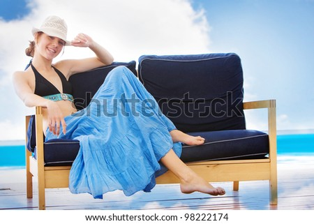 young attractive woman relaxing in beach cafe - stock photo