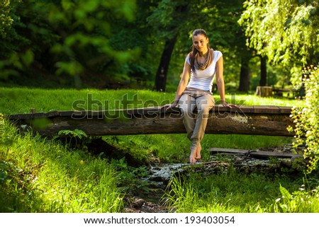 Young attractive woman relaxing in nature.