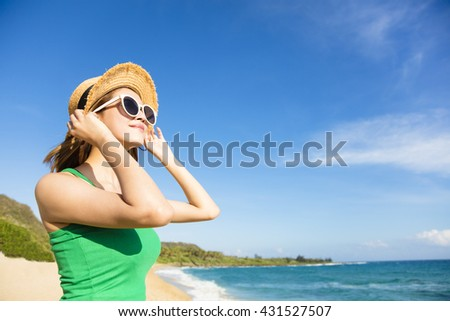 Young attractive woman relaxing on the beach