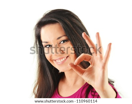 Young attractive woman showing ok sign isolated on white - stock photo