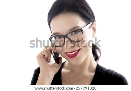 Young attractive woman speaking by mobile phone - stock photo