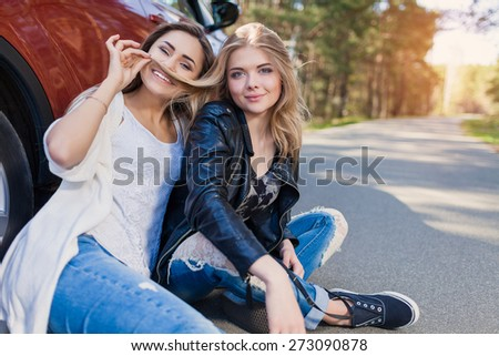 Young attractive woman summer road trip - stock photo