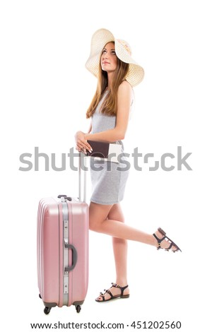 Young attractive woman tourist with a suitcase and tickets isolated on a white background. Recreation and tourism concept. - stock photo