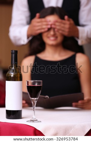 Young attractive woman with closed eyes at the restaurant - stock photo