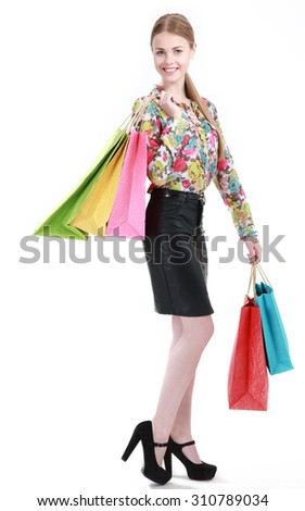Young attractive woman with colored bags on white  - stock photo
