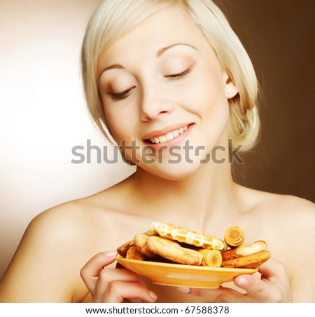 young attractive woman with cookies - stock photo