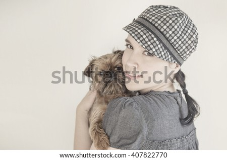Young attractive woman with dog on her hands - stock photo