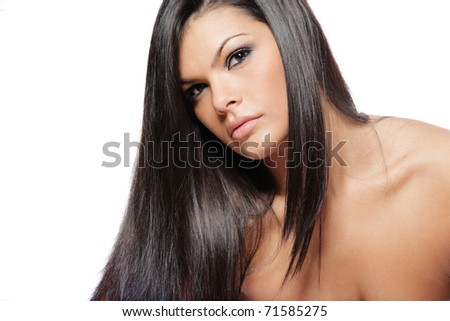 Young attractive woman with long black hair on white background.