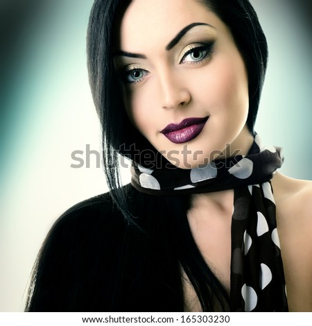 Young attractive woman with nice makeup looking at camera, studio shot of pretty girl - stock photo