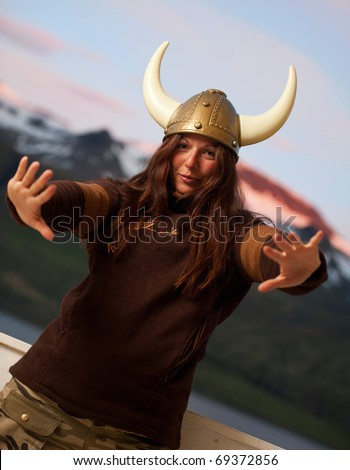 young attractive woman with nordic helmet posing - stock photo