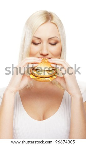 Young attractive woman with the hamburger - stock photo