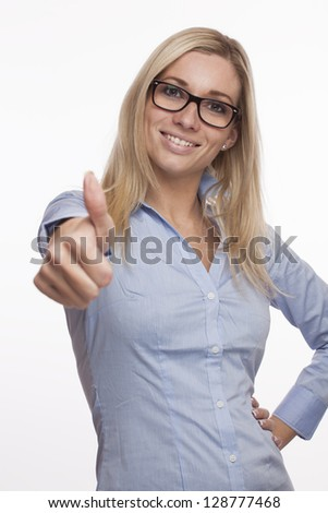 Young attractive woman with thumbs up