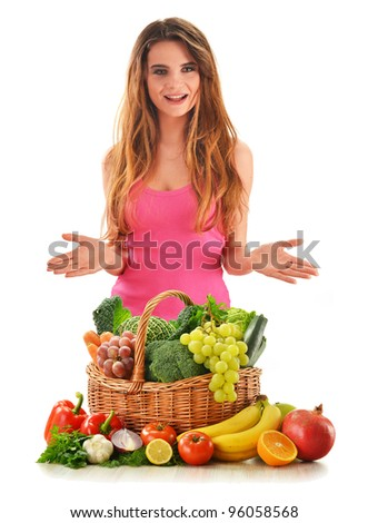 Young attractive woman with variety of fresh vegetables and fruits isolated on white