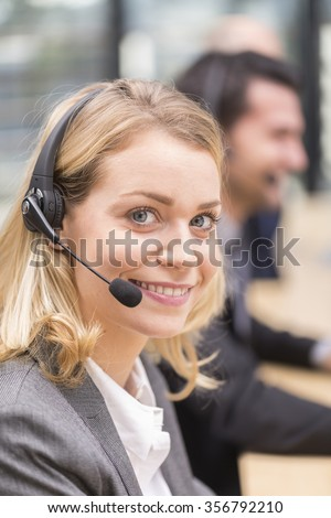Young attractive woman working in a call center - stock photo