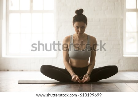 Young Attractive Yogi Woman Practicing Yoga Concept Sitting In Baddha Konasana Exercise Butterfly Pose