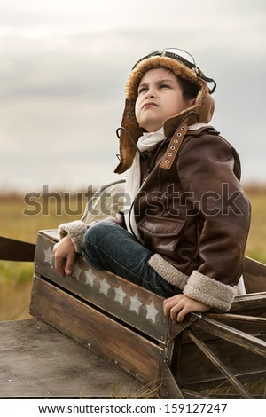 Young Aviator in a homemade aircraft in the autumn afternoon