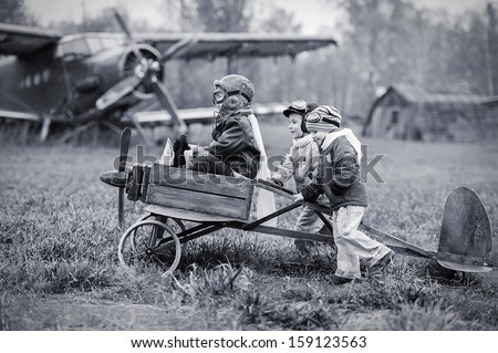 Young aviators at the airport with a homemade airplane