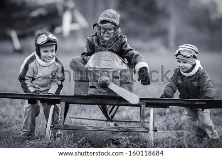 Young aviators at the airport with a homemade airplane - stock photo