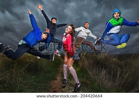 Young b-boy men with girl doing brake dancing movements - stock photo